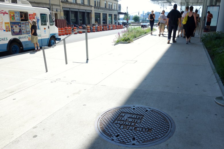 Manhole cover designed by Lawrence Weiner outside the Whitney Museum of American Art