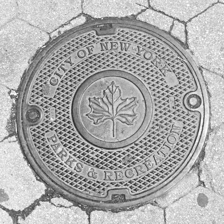 A manhole cover for the New York City Department of Parks & Recreation
