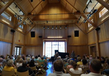 Peter Halstead giving a pre-concert talk in the Olivier Music Barn at Tippet Rise