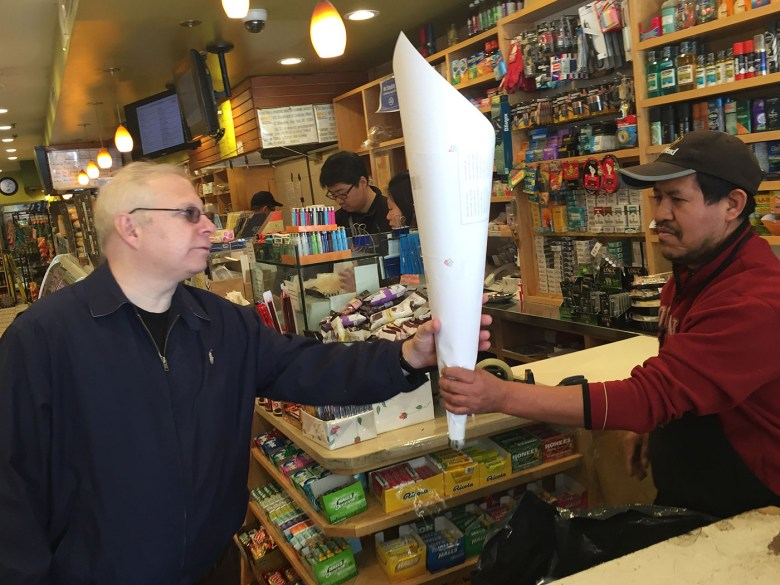 A customer buys flowers wrapped in Hewson's Fair Trade paper