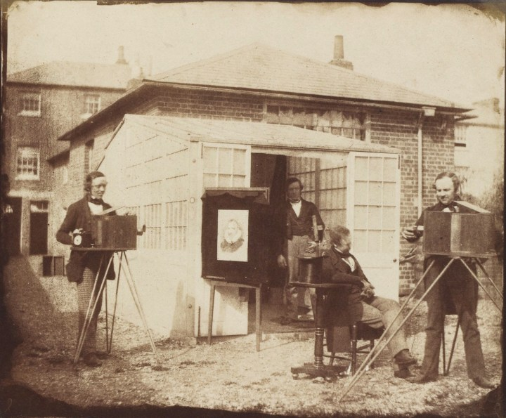 William Henry Fox Talbot and others at a commercial calotype establishment in Reading, England (1846) (via Wikimedia)