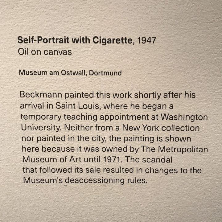 """Wall text accompanying Max Beckmann, """"Self-Portrait with Cigarette"""" (1947) in Max Beckmann in New York at the Metropolitan Museum of Art (photo by the author for Hyperallergic)"""