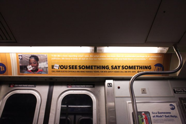 "One of the substitute MTA ads, which reads: ""I felt like a hero reporting what I saw. But what scares me more than an unattended package is an unattended politician. We have to keep an eye on how our representatives vote and hold them accountable."""