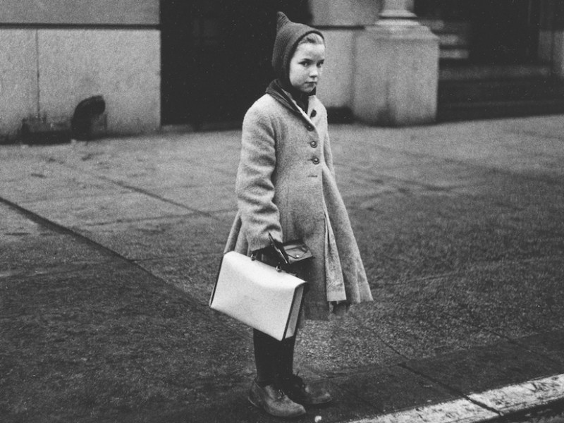 "Diane Arbus, ""Girl with a pointy hood and white schoolbag at the curb, N.Y.C."" (1957) (courtesy The Metropolitan Museum of Art, New York; copyright © The Estate of Diane Arbus, LLC; all rights reserved)"