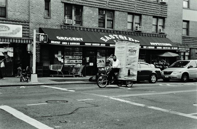 "Janet Russek and David Scheinbaum, ""Mobile Sukkah, Grand Street"" (2012) from <em srcset="