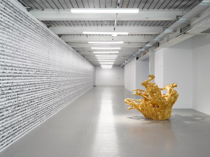 "Ai Weiwei, wall Work: ""Odyssey"" (2016); floor works: ""Iron Tree Trunk"" (2015), ""Iron Root"" (2015) (photo by Jack Hems