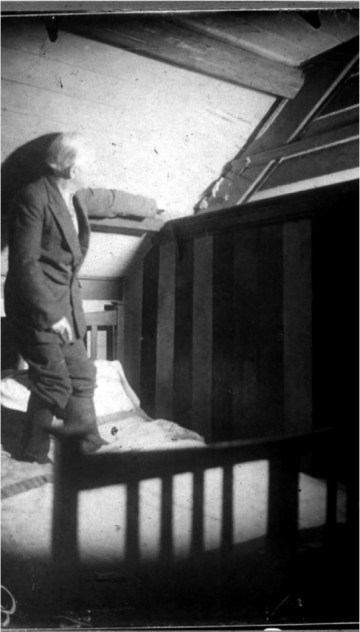 """""""'How Gef showed his fingers' — Irving is pointing towards a pair of white, hand-like objects that protrude from the gap between the wooden rafter and the sloping roof. Note that he appears to be wearing boots whilst clambering upon his bed!,"""" from <em srcset="""