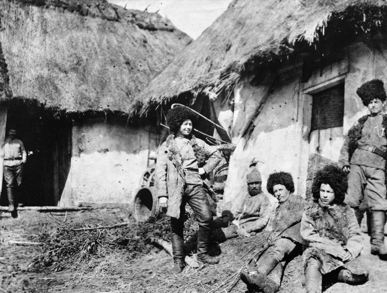"""Florence Farmborough, """"Russian Cossack troops in winter uniforms outside their accommodation huts."""" (© IWM (Q98429)"""