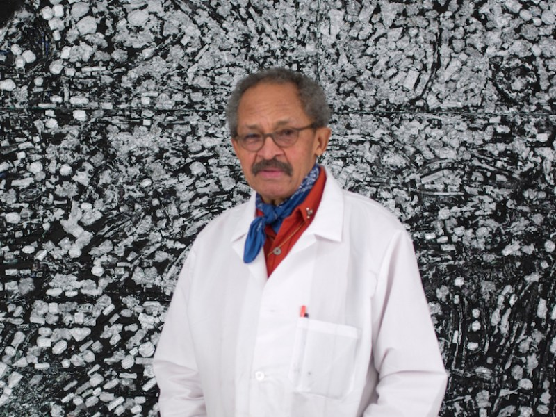 """Jack Whitten in front of his painting """"Atopolis: For édouard Glissant"""" (2014) (photo by John Berens, © Jack Whitten, courtesy the artist and Hauser & Wirth)"""