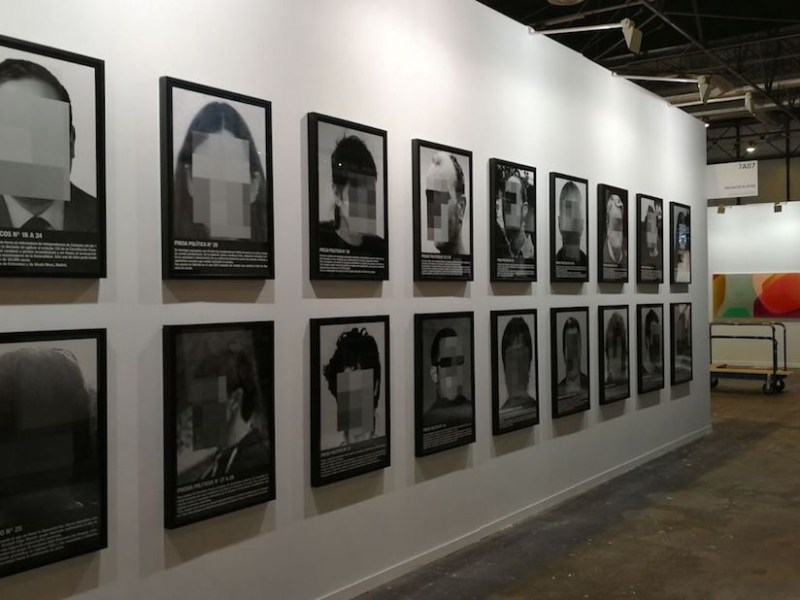 """Santiago Sierra, """"Political Prisoners in Contemporary Spain"""" (2018) on view at the Helga de Alvear booth during the installation of Madrid's ARCO art fair (courtesy the artist and Helga de Alvear)"""
