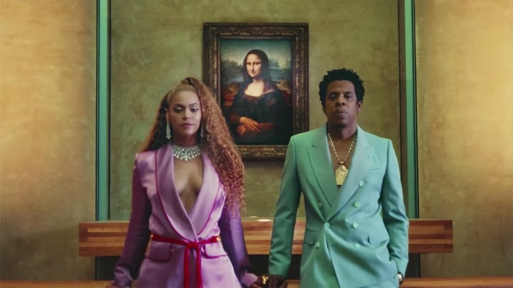 "Beyoncé and Jay-Z in front of Leonardo da Vinci's Mona Lisa in the video for ""Apeshit"" (all screenshots by Hyperallergic via YouTube)"