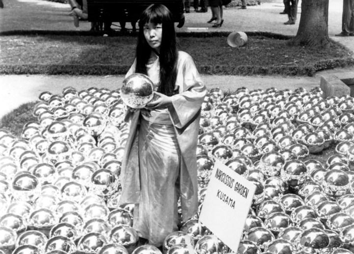 "Yayoi Kusama with ""Narcissus Garden"" (1966) installed in Venice Biennale, Italy, 1966 (©YAYOI KUSAMA, courtesy David Zwirner, New York; Ota Fine Arts, Tokyo/Singapore/Shanghai; Victoria Miro, London/Venice)"