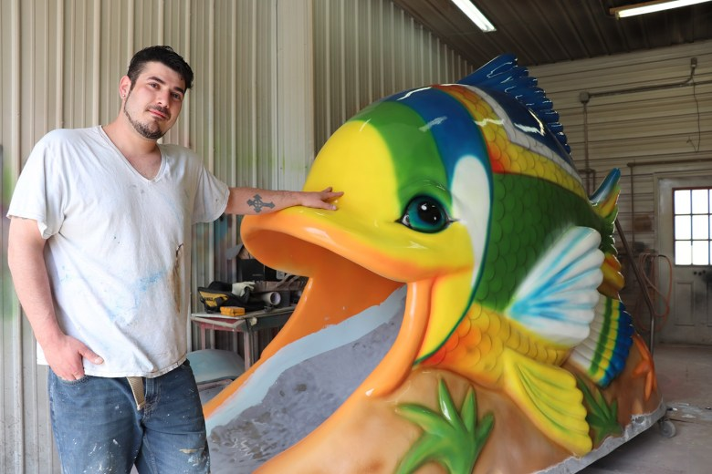 Eugene Ortize with a tropical fish (photo by the author for Hyperallergic)