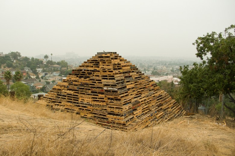 "Liz Glynn, ""III"" (2010), reclaimed forklift pallets, 9 performances, 27 x 27 x 17 ft., Los Angeles, CA"