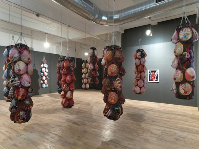 "Zhen Guo, ""Punching Bag"" (2014-15), sewing, collage, and painting, each: 72 x 18 x 18 in. (image courtesy of the artist)"