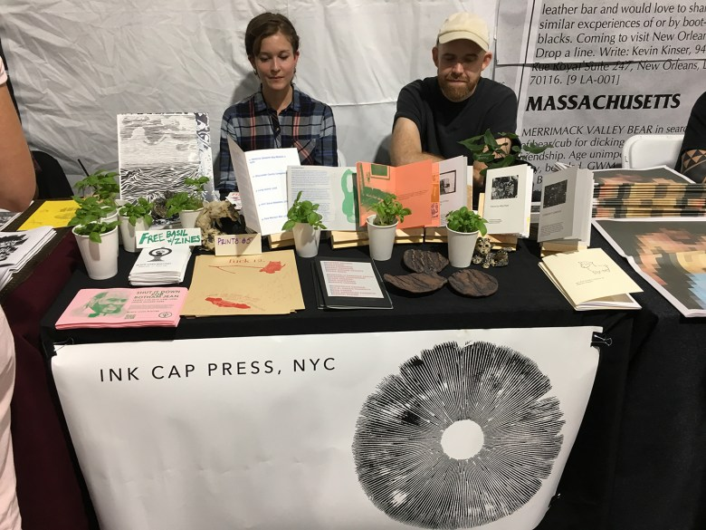 Babbie Donnington (left) and Thompson Harris (right) with free basil at the table for Ink Cap Press