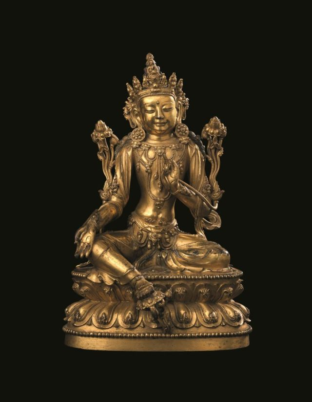 A rare and finely-cast gilt-bronze seated figure of Avalokiteshvara Xuande six-character incised mark and of the period (1426–1435)