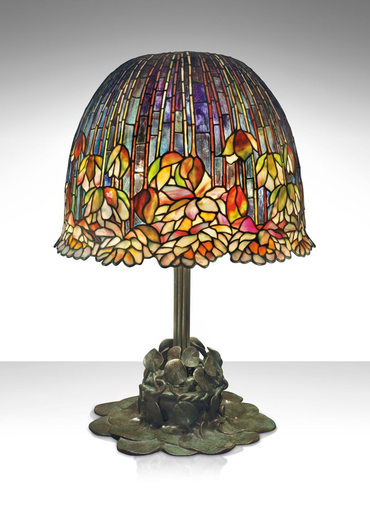 "Tiffany Studios, a rare and important ""Pond Lily"" table lamp (c. 1903), leaded glass, patinated bronze, 26 1/2 inches high, 18 inches diameter of shade (image courtesy Christie's)"