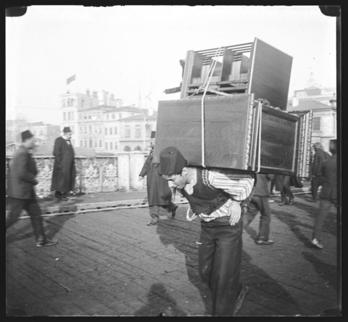 Turkish man carrying furniture on his back (c. 1900), glass plate negative