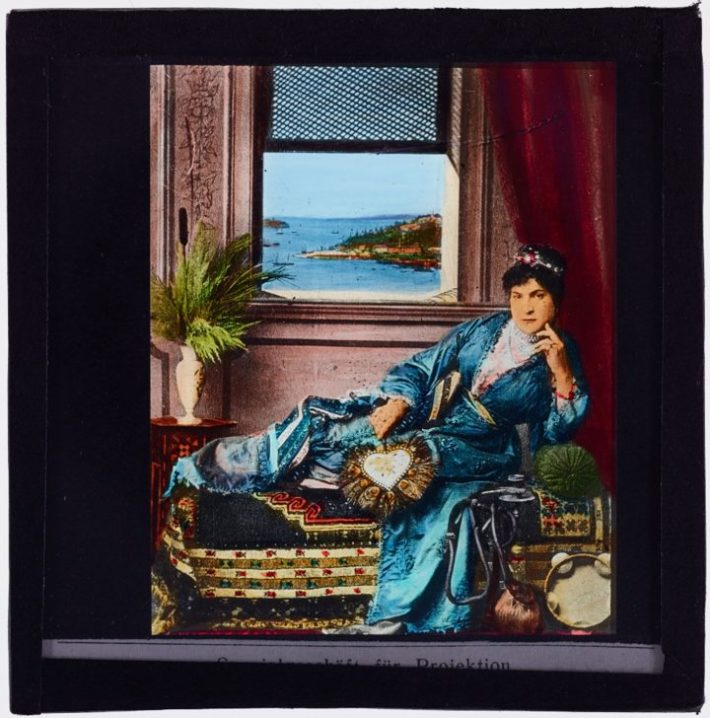 Woman reclining on couch (1900), glass lantern slide