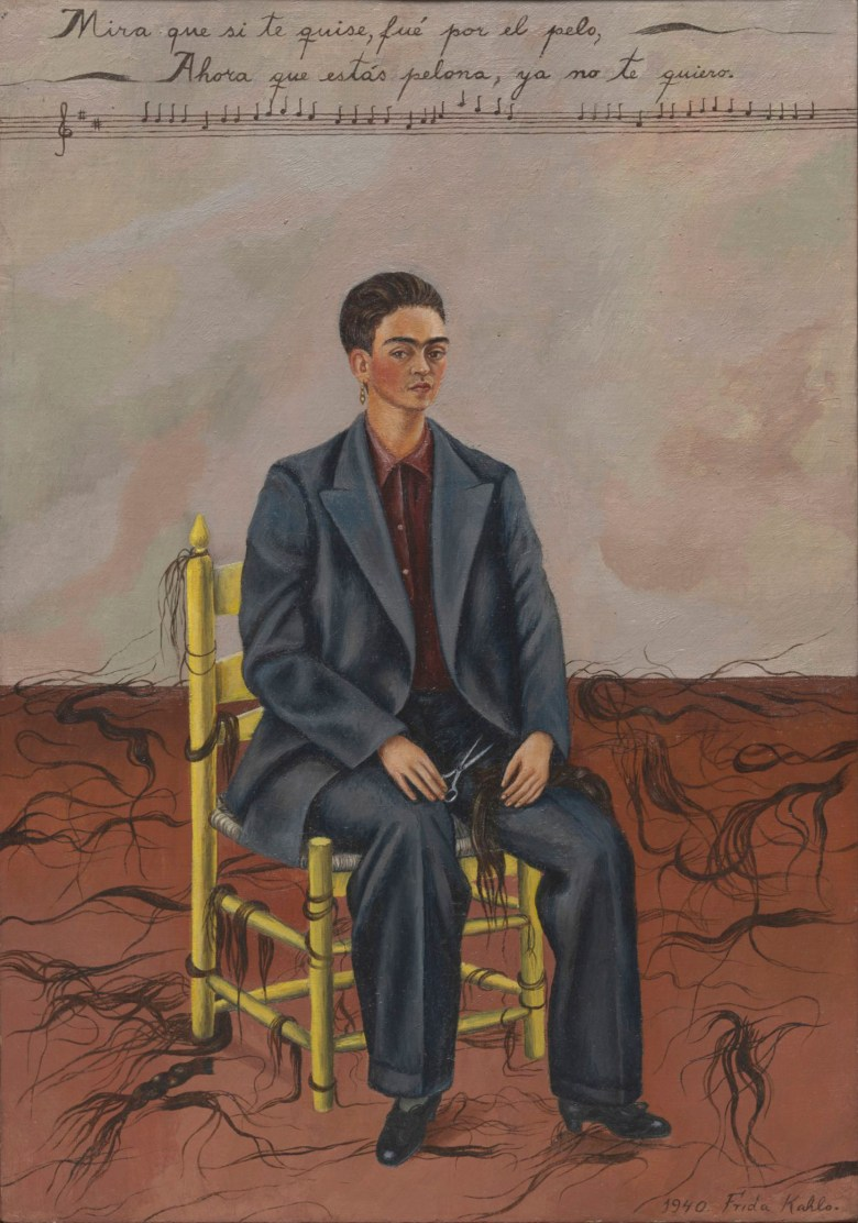 """Frida Kahlo, """"Self-Portrait with Cropped Hair"""" (1940), oil on canvas, 15 3/4 x 11 inches (Museum of Modern Art, Gift of Edgar Kaufmann, Jr., © 2019 Banco de México Diego Rivera Frida Kahlo Museums Trust, Mexico, D.F. / Artists Rights Society (ARS), New York, Digital Image © The Museum of Modern Art/Licensed by SCALA / Art Resource, NY)"""