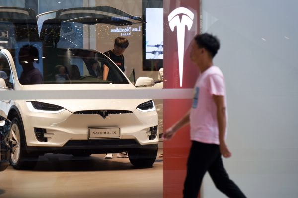 tesla summoned by chinese regulators for quality concerns hyperedge embed image