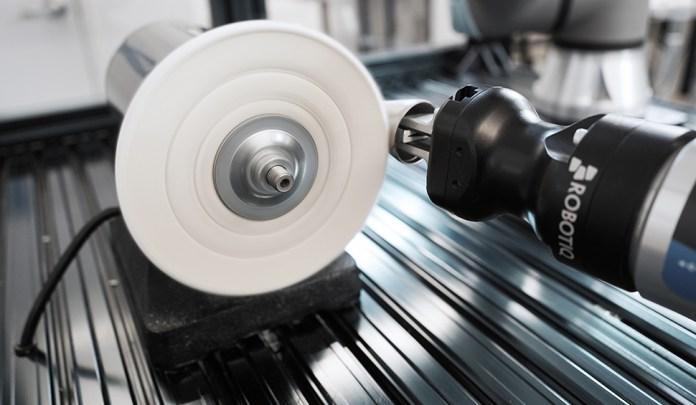 Robotiq Hand-e gripper using force sensing software to polish a door knob for a collaborative robot application.