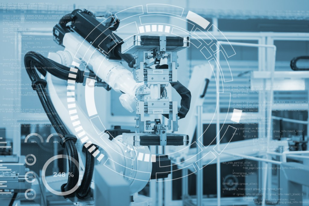 Automatic robot mechanical arm is working in the modern automobile parts factory.