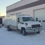 Furnace and Duct Cleaning front grill truck in snow