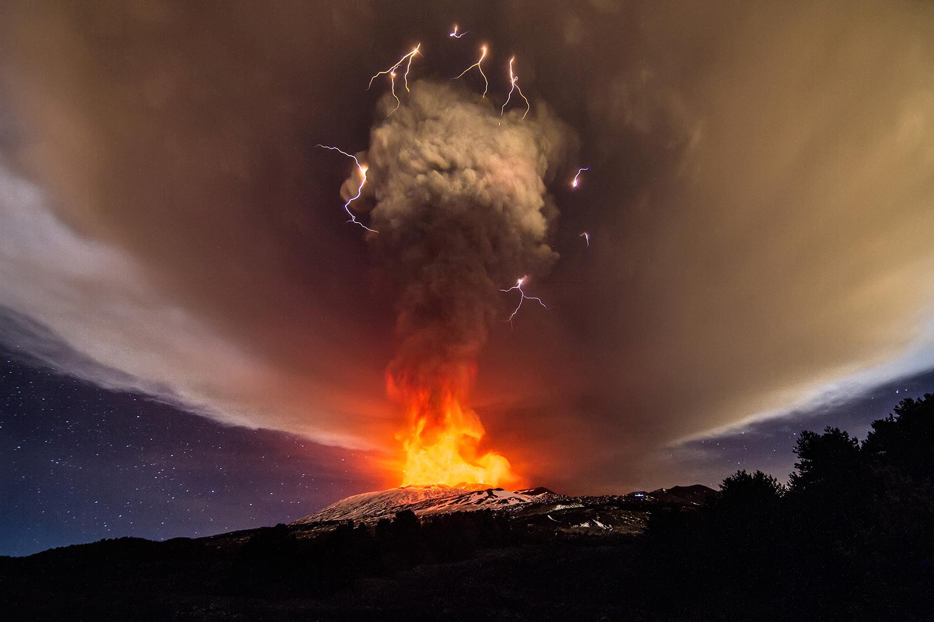 Explosions from Mount Etna's Voragine crater light up night sky