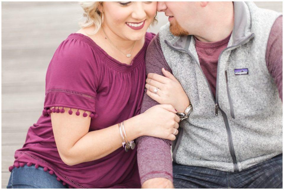 engaged couple posing on a bridge