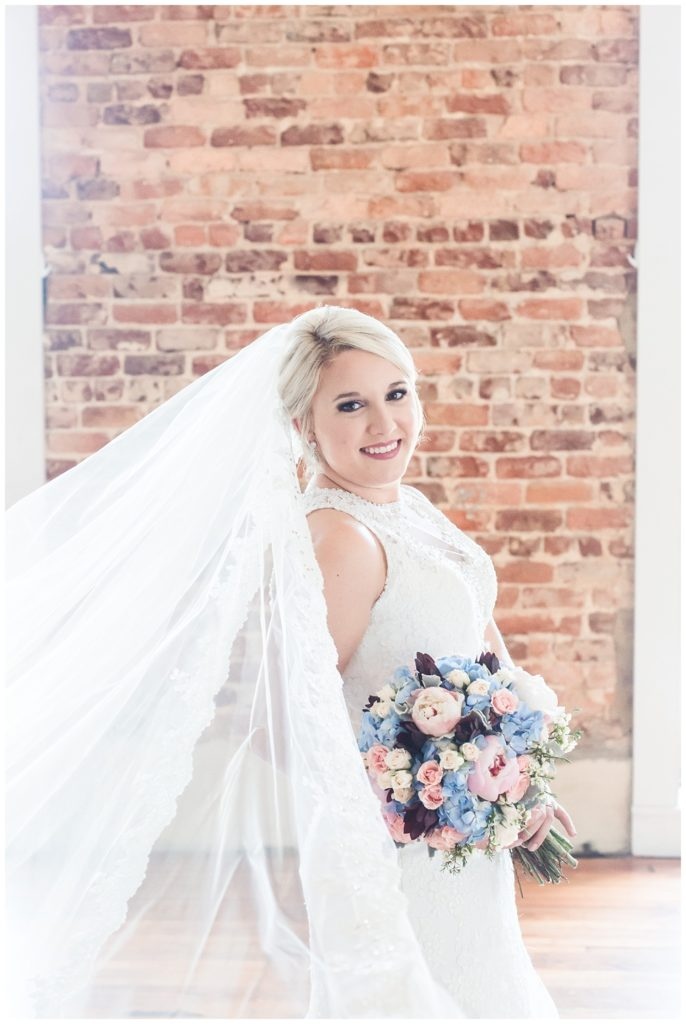 bridal portrait session at the laboratory mill with a cathedral veil