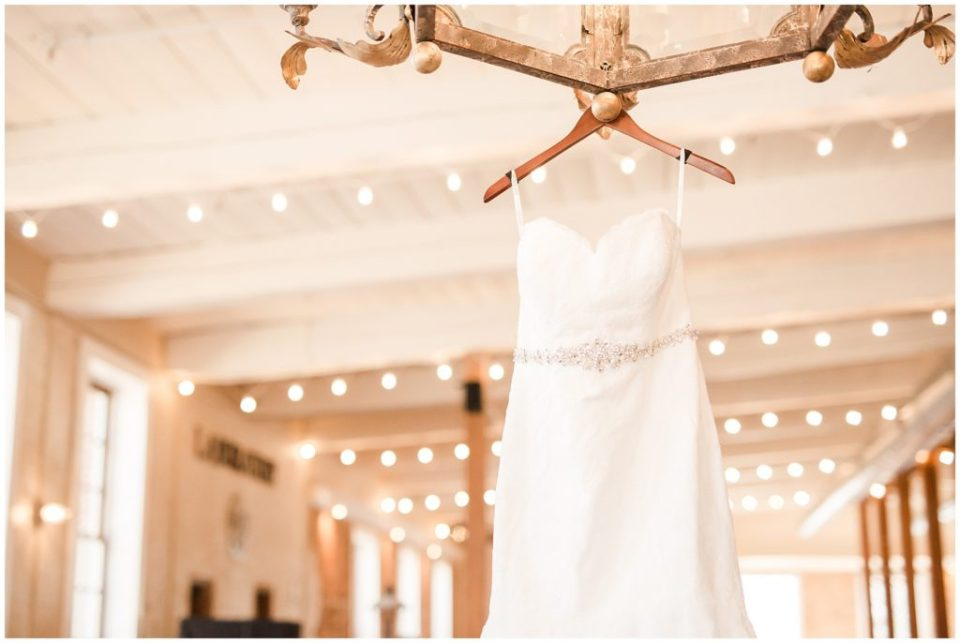 wedding dress hanging, beautiful navy and burgundy wedding at the laboratory mill with hypimages