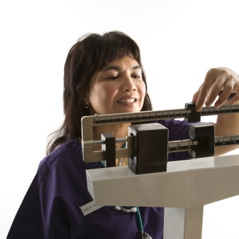 BMI Calculator Woman Using Scales