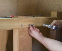 I am hammering the nails. The nails are long enaugh to go trough the tenon. Photo: Roald Renmælmo