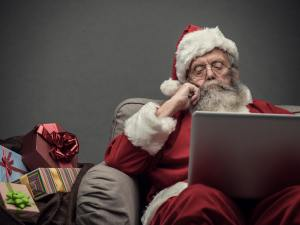 Santa Claus connecting with a laptop