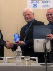 Chris Wargo (center), with Dr. Nikos Fistas and Tom Redling