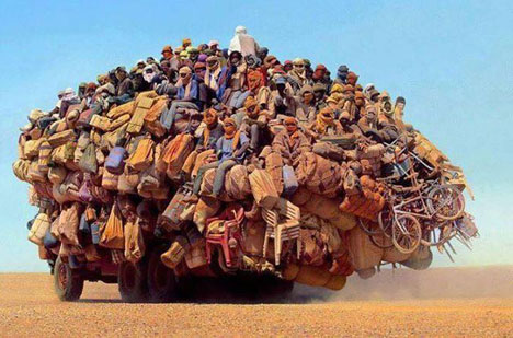 Overcrowded Public Transport Crowded lorry heading down south in Algeria