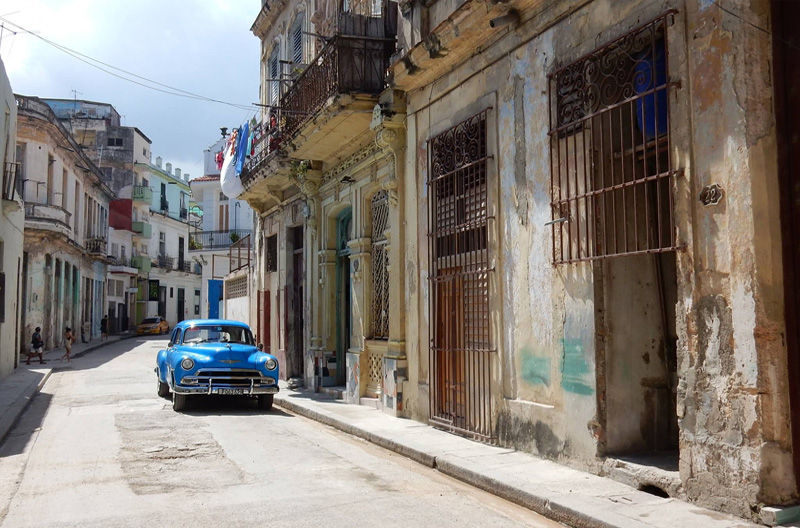 Cuba tourism. Rotten but clean side alley in Havana. Photo by