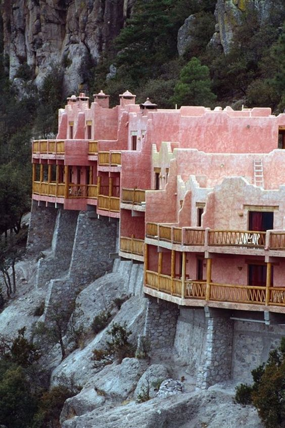 The Grand Sugar Pink Clifftop Hotel - Not the usual Mexico Cancun or Acapulco destination, we are in the northwestern region of Chihuahua where a most eccentric and isolated Hotel Posada Mirador perches over cliffs that are four times greater in magnitude than that of the Grand Canyon.