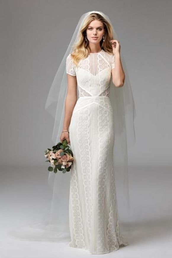 In-stock Wtoo by Watters Lenora 17120B! Ships within 1-2 business days! Returnable! Please see our Return Policy for In-Stock Wedding Dresses. Available in OffWhite/Oyster.  For the bride who loves a polished look, Lenora is the answer. Boasting our classic Circle Lace, Lenora features a high neckline with cap sleeves.