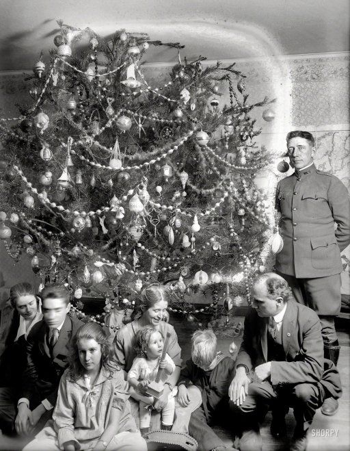 "Like! ""Dickey Christmas tree -- 1918."" When Christmas trees were still wild and crazy. I love the crazy tree!"