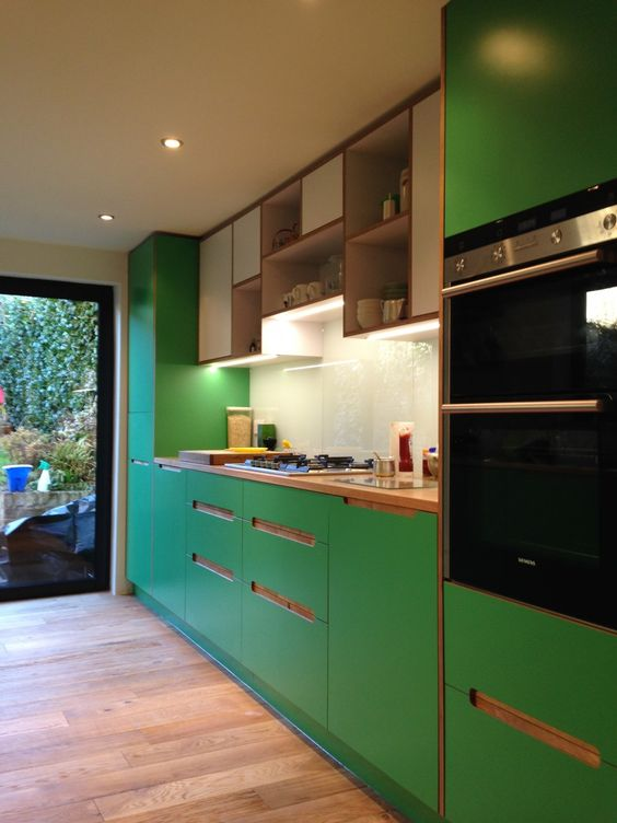 Kitchen - Laminated Plywood, solid Oak, back painted glass, LED in aluminium profile.