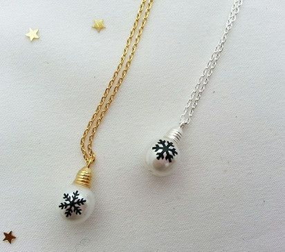 Dimension: the bulb measures approx. 6 x 10 mm Total length measures 15 1/2 inches and it closes with a lobster clasp. Material: plated brass, faux pearl
