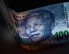 Rand Gains With Bonds as South Africa Dodges Moody's Downgrade By Bloomberg