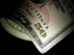 Dollar Edges Lower; Economic Reopening Eyed By Investing.com