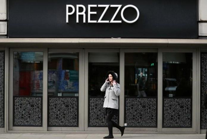 © Reuters. FILE PHOTO: A woman walks past a Prezzo restaurant in London