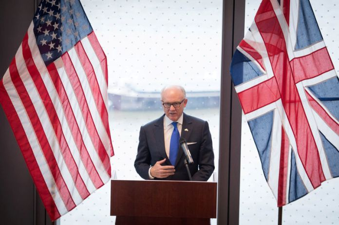 © Reuters. FILE PHOTO: United States ambassador to the Court of St James Woody Johnson speaks during a press preview at the new United States embassy building near the River Thames in London