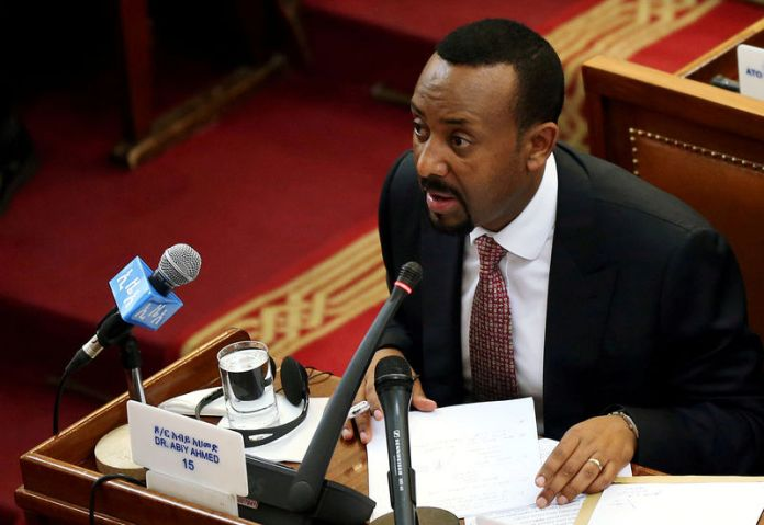 © Reuters. FILE PHOTO: Ethiopia's newly elected Prime Minister Abiy Ahmed addresses the members of parliament inside the House of Peoples' Representatives in Addis Ababa