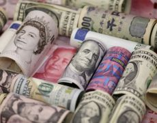 Dollar buoyed by signs of solid U.S. economy, pound ticks up By Reuters